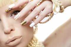 Pearl manicure and makeup. Royalty Free Stock Images