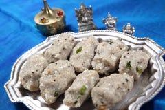 Pearl millet, Rice flakes hot dumplings, Kambu aval kara kozhukattai stock photo
