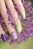 Pearl nail design . Pearl nail design on colored nails with the flower Royalty Free Stock Images