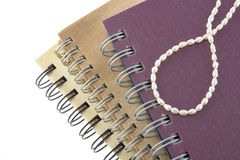 Pearl neaklace decoration on notebook Stock Photography
