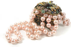 Pearl necklace. Pink pearl necklace in jewelry box, isolated on white Stock Image