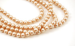 Pearl Necklace. Strands of a pearl necklace wound on a white background Royalty Free Stock Images