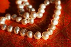 Pearl Necklace. On the table Stock Images