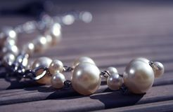 Pearl necklace. Lying on ground Stock Photo