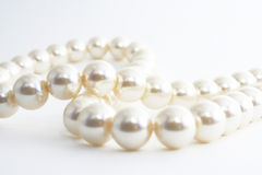 The Pearl necklace. The Pearl necklace on white background.The Fashionable accessory Royalty Free Stock Photo
