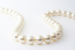 The Pearl necklace. The Pearl necklace on white background.The Fashionable accessory Royalty Free Stock Photos