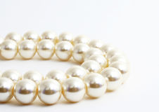 The Pearl necklace. The Pearl necklace on white background.The Fashionable accessory Royalty Free Stock Images