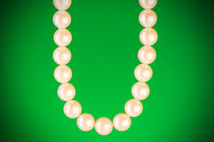 Pearl necklace against  background Royalty Free Stock Images