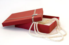 Pearl Necklace as a Gift. Out of Red Box Stock Image
