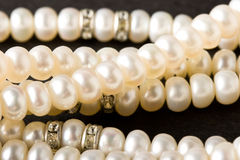 Pearl necklace on black Royalty Free Stock Photos