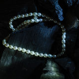 Pearl necklace on black carbon Royalty Free Stock Images