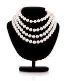 Pearl necklace on black mannequin Royalty Free Stock Image