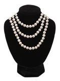 Pearl necklace on black mannequin isolated. On white background Stock Photography