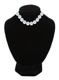 Pearl necklace on black mannequin isolated over white Royalty Free Stock Photos