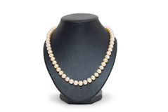 Pearl necklace on black mannequin isolated Stock Photo