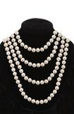 Pearl necklace on black mannequin isolated on white. Background Stock Photo