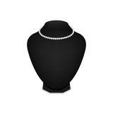 Pearl necklace on black mannequin isolated on a white background. Royalty Free Stock Photos