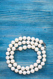 Pearl necklace on a blue background Royalty Free Stock Images