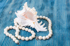 Pearl necklace on a blue background Royalty Free Stock Photo
