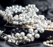 Pearl necklace with blurred background on black Royalty Free Stock Photo