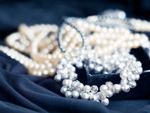 Pearl necklace with blurred background on black Stock Image