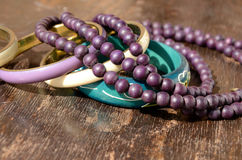 Pearl Necklace and Bracelets. Wooden Pearl Necklace and Bracelets stock images
