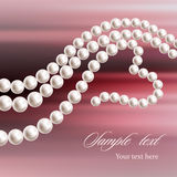 Pearl necklace on a Colored background. Necklace heart shaped. Stock Images