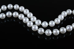 pearl necklace on a dark background Royalty Free Stock Image