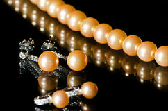 Pearl necklace and earrings Stock Image