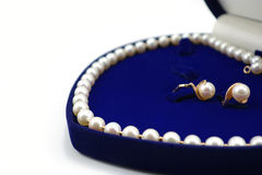 Pearl necklace and earrings in heart-shaped box Stock Image
