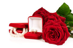 Pearl necklace and earrings in a red gift box with a roses Royalty Free Stock Image