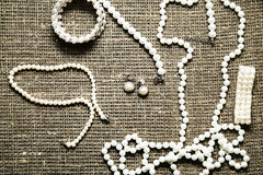 Pearl necklace on fabric material. Photo of Pearl necklace on fabric material Stock Photography