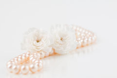 Pearl necklace with flowers Royalty Free Stock Images