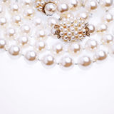 Pearl necklace fragment over white background Royalty Free Stock Images
