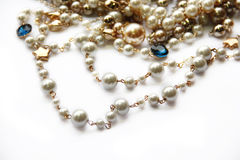 Pearl necklace. Pearl necklace and golden decoration  on white background Royalty Free Stock Photo