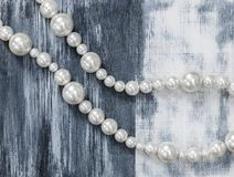 Pearl necklace on gray artistic background. Beauty and fashion concept royalty free stock photo