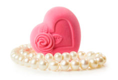 Pearl necklace with a heart-shaped box. Isolated on white stock photo