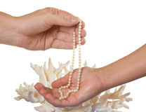 A pearl necklace in her hand Stock Photo