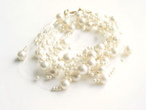 Pearl necklace (high key). White background royalty free stock image