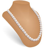 Pearl necklace in the jewelry bust. Royalty Free Stock Photos