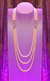 Pearl necklace. Pearl jewelry necklace presented on a bust Royalty Free Stock Photography