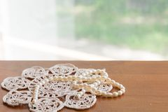 Pearl necklace on a lacy napkin Stock Photo