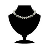 Pearl necklace on mannequin Stock Images