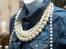 Pearl Necklace. This is a picture a mannequin wearing a blue shirt and pearl necklace Stock Photos