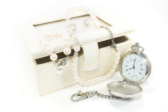 Pearl necklace and pocket watch Royalty Free Stock Photo