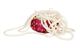Pearl necklace in a red Chinese silk box Royalty Free Stock Photos