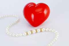 Pearl necklace and red heart shape Royalty Free Stock Photo