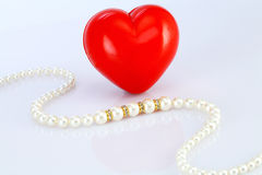 Pearl necklace and red heart shape Royalty Free Stock Images