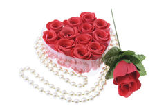Pearl Necklace and Red Roses. On White Background Royalty Free Stock Image