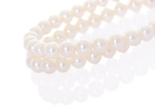 Pearl necklace with reflection Royalty Free Stock Photography